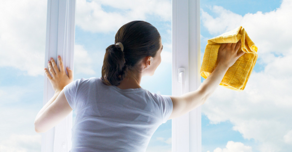 woman cleaning window glass